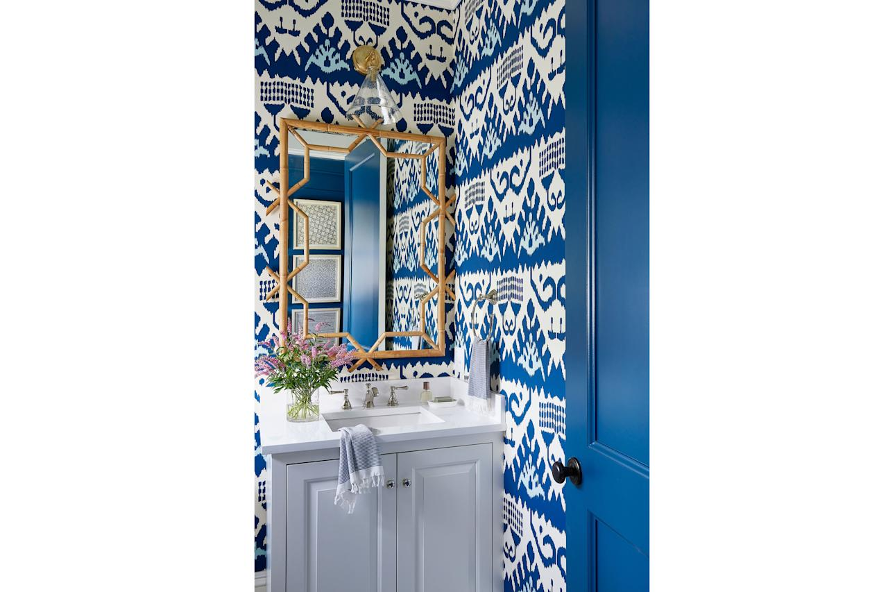 "<p>This striking powder room is covered in an intricate ikat wallpaper from Quadrille Fabrics. Designer <a href=""https://markdsikes.com"" target=""_blank"">Mark D. Sikes</a> added a single glass cone vanity sconce about the mirror for balance. ""It's very simple in form, which makes it perfect against all of that pattern,"" he says.</p> <ul><li><a href=""https://www.coastalliving.com/homes/idea-houses/newport-rhode-island-idea-house"" target=""_blank"">Tour the rest of our 2017 Idea House in Newport, Rhode Island.</a></li> </ul><p><strong>Idea Spotlight:</strong> Hang a rattan mirror to add natural texture to a heavily patterned room.</p>"