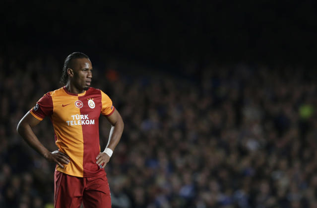 Galatasaray's Didier Drogba puts his hands on his hips as he waits for play to restart during the Champions League last 16 second leg soccer match between Chelsea and Galatasaray at Stamford Bridge stadium in London, Tuesday, March 18, 2014. (AP Photo/Matt Dunham)