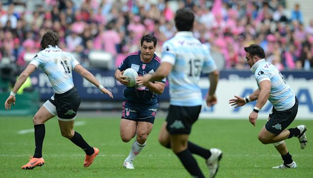 Stade Francais' centre Martin Rodriguez Gurruchaga (C) runs with the ball during the French Top 14 rugby union match Stade Francais vs. Racing Metro on May 5, 2012 at the Stade de France stadium in Saint-Denis. AFP PHOTO / FRANCK FIFEFRANCK FIFE/AFP/GettyImages