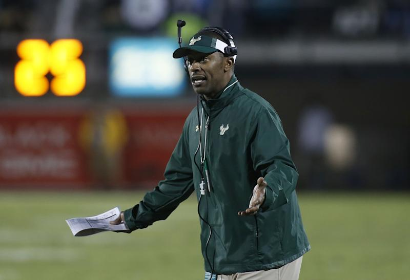 South Florida head coach Willie Taggart yells at the referee. (AP Photo/Reinhold Matay)