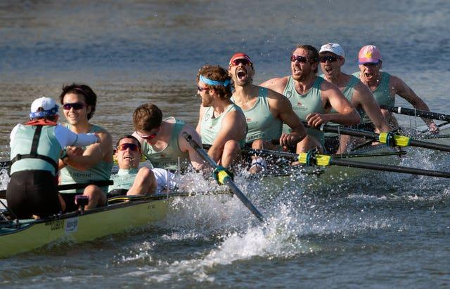 Cambridge celebrate winning the 166th Men's Boat Race on the River Great Ouse near Ely in Cambridgeshire