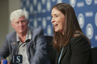 Catie Griggs is introduced as the Seattle Mariners new president of business operations by John Stanton, the team's chairman and managing partner, during a baseball a press conference on Wednesday, July 28, 2021, (AP Photo/Jason Redmond)