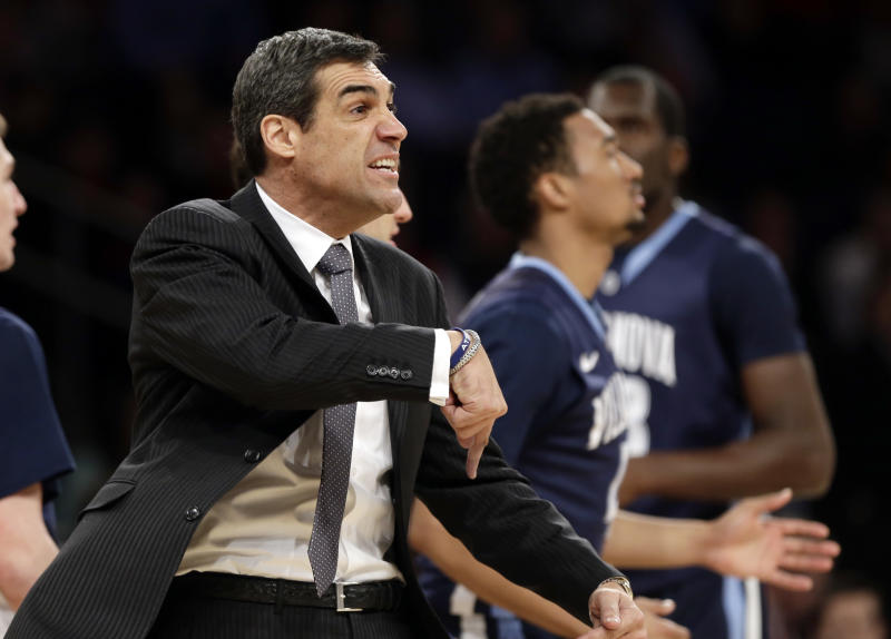 FILE - In this March 14, 2013, file photo, Villanova head coach Jay Wright reacts during the first half of an NCAA college basketball game against the Louisville at the Big East Conference tournament in New York. After a slow start and more doubts hovering over coach Wright, the Wildcats appear back where they belong on the strength of a boatload of Top Ten upsets, and some never-say-die guards. Villanova will meet North Carolina in Round 2 of the NCAA college basketball tournament. (AP Photo/Frank Franklin II, File)