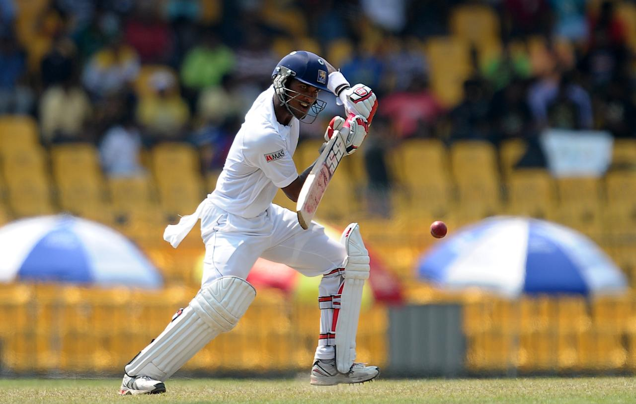 Sri Lanka's cricketer Dinesh Chandimal plays a shot during the second day of their second Test match between Sri Lanka and Bangladesh at the R. Premadasa Cricket Stadium in Colombo on March 17, 2013. AFP PHOTO/ LAKRUWAN WANNIARACHCHI