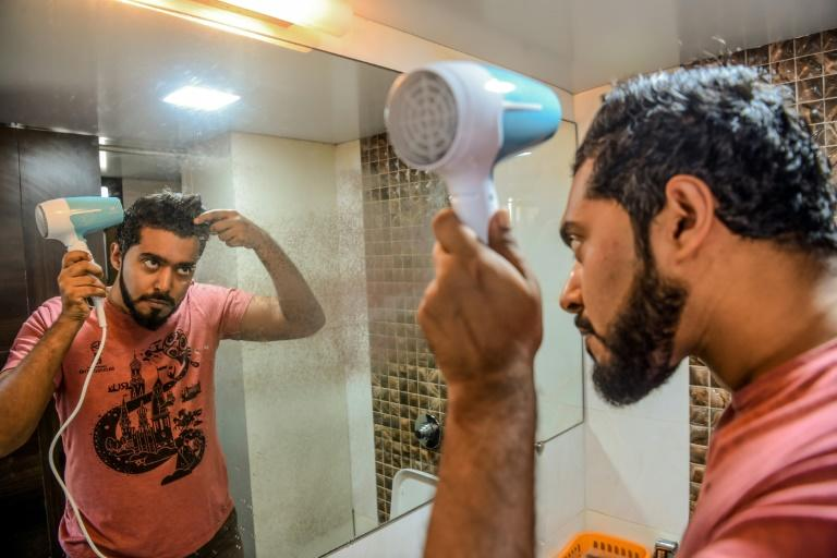 Mumbai-based communications executive Suraj Balakrishnan's regimen includes oils for his beard, body and hair (AFP Photo/Indranil MUKHERJEE)