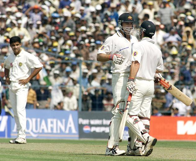 Michael Slater (right) of Australia laughs with team mate Matthew Hayden after being caught off a no ball , bowler Saurav Ganguly of India  looks on, during day one of the 2nd Test between India and Australia played at Eden Gardens, Calcutta, India. X DIGITAL IMAGE  Mandatory Credit: Hamish Blair/ALLSPORT