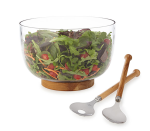 """<p>Serving dishes are what registries are made for, and a big batch salad bowl is high on the list of pieces you need. The oak bottom on this glass bowl acts as a built-in trivet for warm pasta salads.</p><p><strong><em>BUY IT NOW: Salad Bowl Serving Set With Oak Base, $80; </em></strong><a href=""""https://www.uncommongoods.com/product/salad-bowl-serving-set-with-oak-base"""" rel=""""nofollow noopener"""" target=""""_blank"""" data-ylk=""""slk:Uncommongoods.com"""" class=""""link rapid-noclick-resp""""><strong><em>Uncommongoods.com</em></strong></a></p>"""