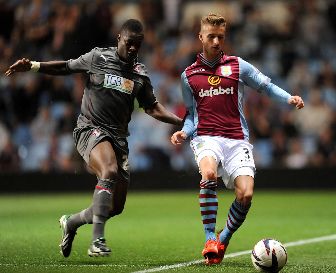 Aston Villa's Joe Bennett and Rotherham United's Kieran Agard challenge for the ball during the Capital One Cup, Second Round match at Villa Park, Birmingham.