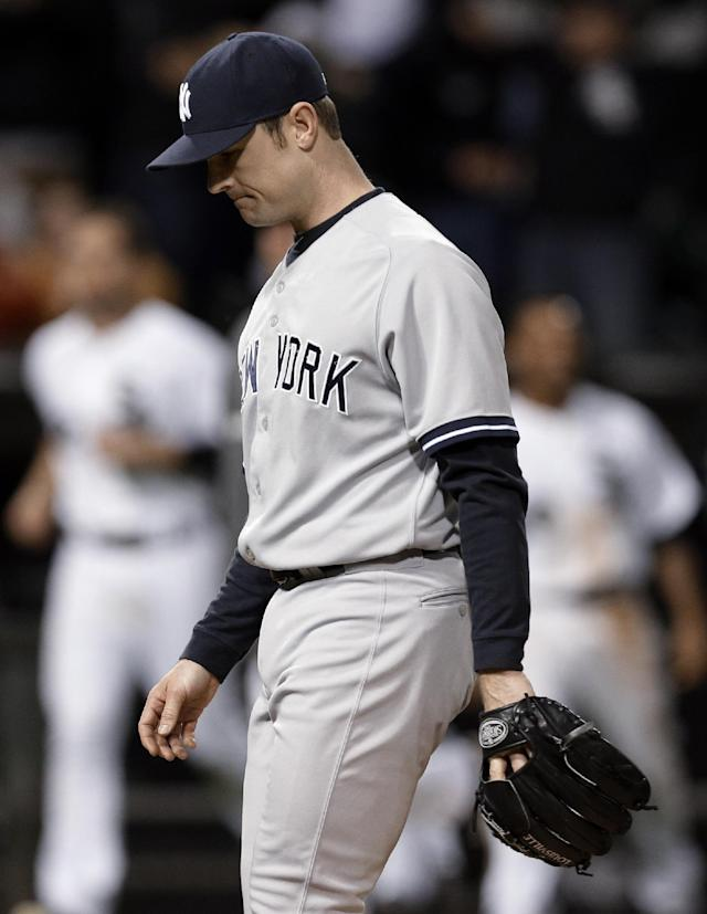 New York Yankees closer David Robertson looks down as he leaves the field after Chicago White Sox's Adam Dunn hit the game-winning two-run home run during the ninth inning of a baseball game in Chicago on Friday, May 23, 2014. Chicago won 6-5. (AP Photo/Nam Y. Huh)