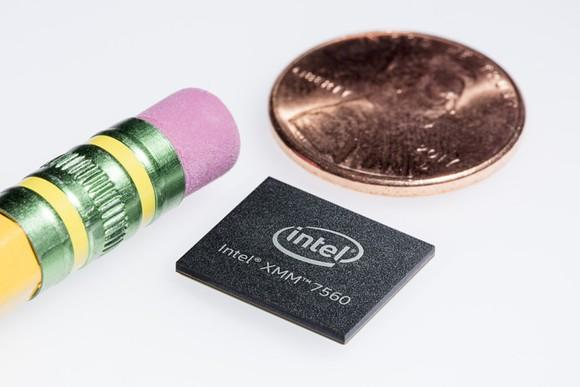 Intel's XMM 7560 modem next to a penny and a pencil eraser.