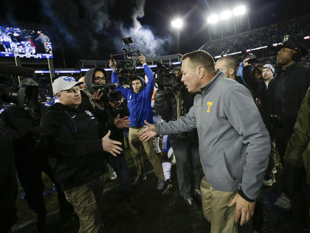 Tennessee head coach Butch Jones greets Kentucky head coach Mark Stoops on the field after Kentucky defeated Tennessee 29-26 in an NCAA college football game Saturday, Oct. 28, 2017, in Lexington, Ky. (AP Photo/David Stephenson)