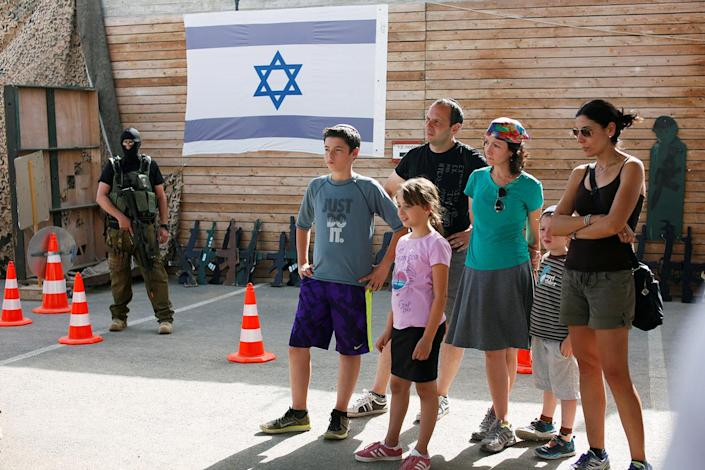 "<p>A group of tourists take part in a two hour ""boot camp"" experience, at ""Caliber 3 Israeli Counter Terror and Security Academy"" in the Gush Etzion settlement bloc south of Jerusalem in the occupied West Bank July 13, 2017. (Photo: Nir Elias/Reuters) </p>"