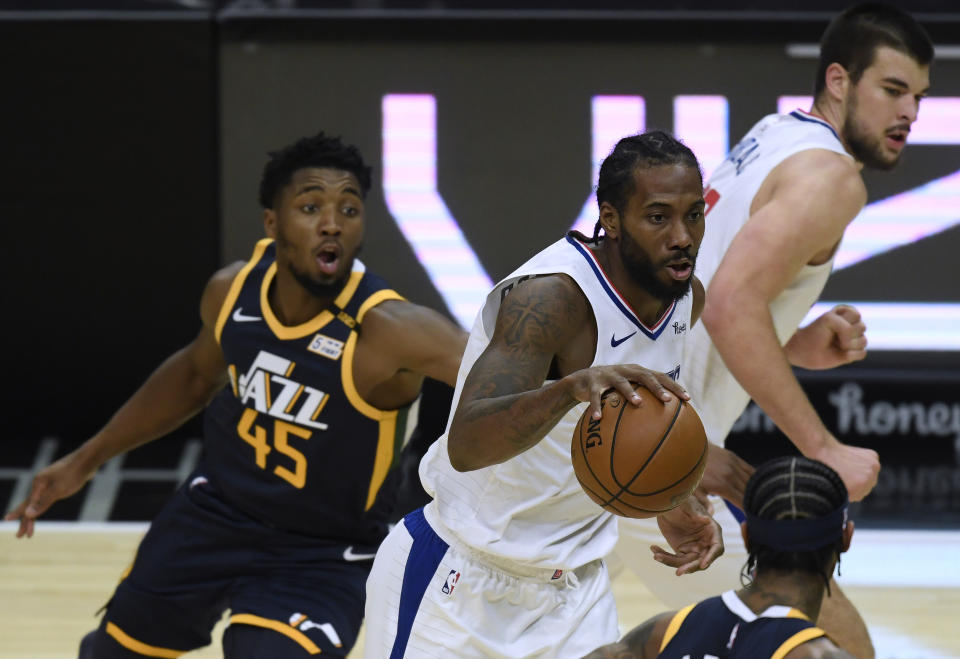 Can Clippers star Kawhi Leonard keep Jazz counterpart Donovan Mitchell on his heels? (Harry How/Getty Images)