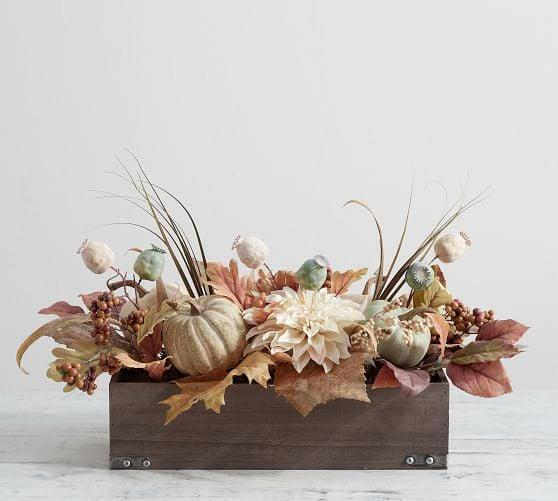 <p>The <span>Pumpkin Centerpiece</span> ($179) is arranged with daisy flowers, grass, oak leaves, pumpkin, poppy pods, and more. </p>