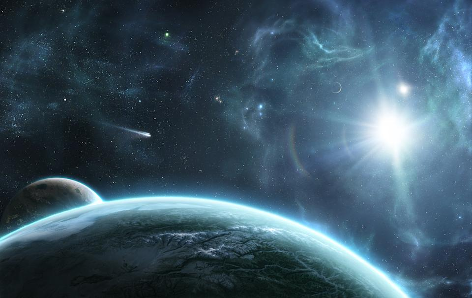 Digitally created space scene with the orbital view on the Earth-like planet and it's moons with the blue star, comet and nebulae in the back. Perfect for scientific fiction, futuristic or game illustration.