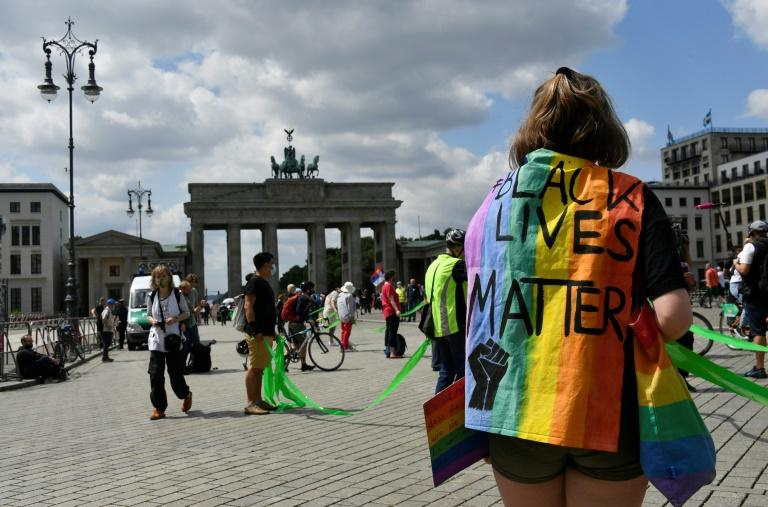 The route of the human chain -- stretching from the world-famous Brandenburg Gate past the landmark Communist-era TV tower at Alexanderplatz and into the ethnically diverse Neukoelln district -- had to be extended to accommodate the numbers (AFP Photo/John MACDOUGALL)