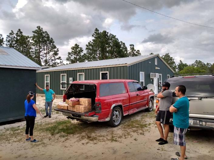 The Episcopal Farmworker Ministry, based in Harnett County, serving seasonal farmworkers at Sleepy Creek Farms in Bladen County with needed groceries in April 18. A coronavirus outbreak had not yet been reported at the farm.