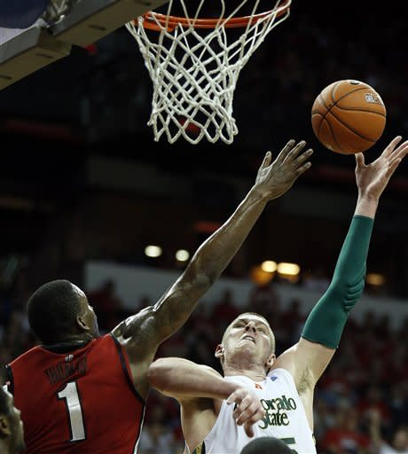 Colorado State's Colton Iverson shoots over UNLV's Quintrell Thomas during the first half of a Mountain West Conference tournament NCAA college basketball game on Friday, March 15, 2013, in Las Vegas. (AP Photo/Isaac Brekken)