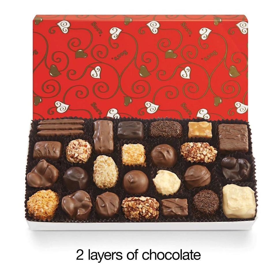 """<p>sees.com</p><p><strong>$23.50</strong></p><p><a href=""""https://www.sees.com/chocolate/assortments/chocolate-and-variety/200394.html?cgid=valentines-day-gifts"""" rel=""""nofollow noopener"""" target=""""_blank"""" data-ylk=""""slk:BUY NOW"""" class=""""link rapid-noclick-resp"""">BUY NOW</a></p><p>You can't go wrong with <a href=""""https://www.delish.com/food-news/a26091616/sees-candies-factory-tour/"""" rel=""""nofollow noopener"""" target=""""_blank"""" data-ylk=""""slk:a box of See's"""" class=""""link rapid-noclick-resp"""">a box of See's</a>. The west coast-based candy shop is known for its delicious soft centered candies and chews, and this two-layer box will leave you and your SO plenty to share.</p>"""