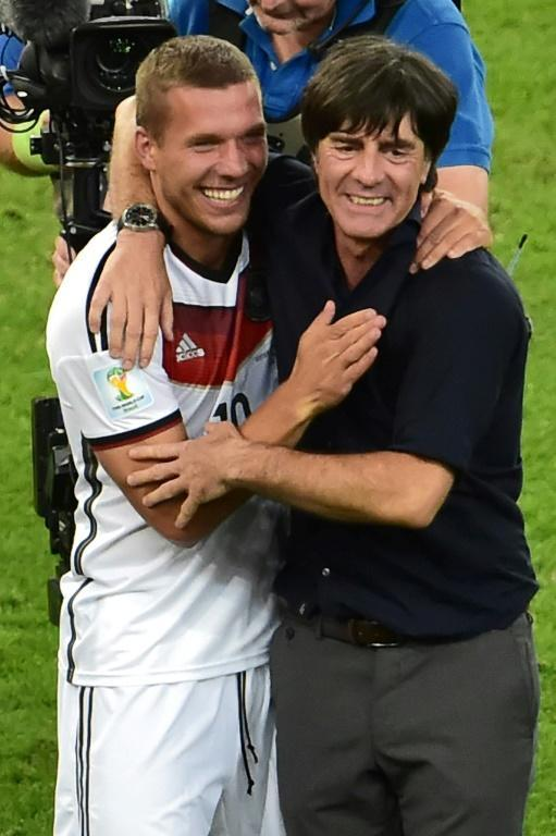 For Joachim Loew, celebrating victory at the Maracana with forward Lukas Podolski, the 2014 World Cup is the benchmark