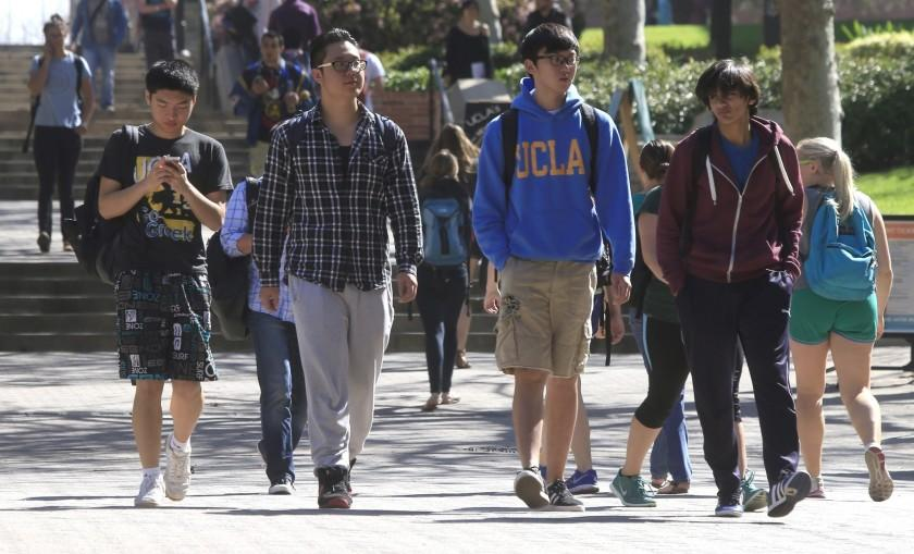 """The Trump administration told international students at U.S. colleges and universities that they couldn't stay in this country if they did not attend classes this fall in person. Shown are students at UCLA. <span class=""""copyright"""">(Los Angeles Times)</span>"""