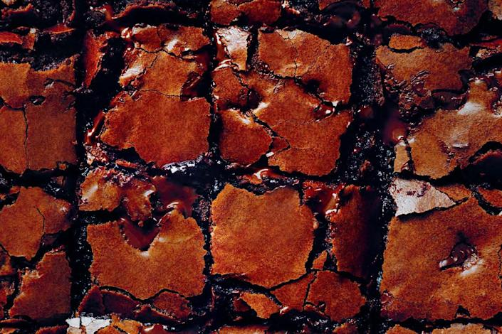"""These gooey brownies have shards of dark chocolate stirred into the batter. And that's a good thing, indeed. <a href=""""https://www.epicurious.com/recipes/food/views/molten-chocolate-chunk-brownies?mbid=synd_yahoo_rss"""" rel=""""nofollow noopener"""" target=""""_blank"""" data-ylk=""""slk:See recipe."""" class=""""link rapid-noclick-resp"""">See recipe.</a>"""