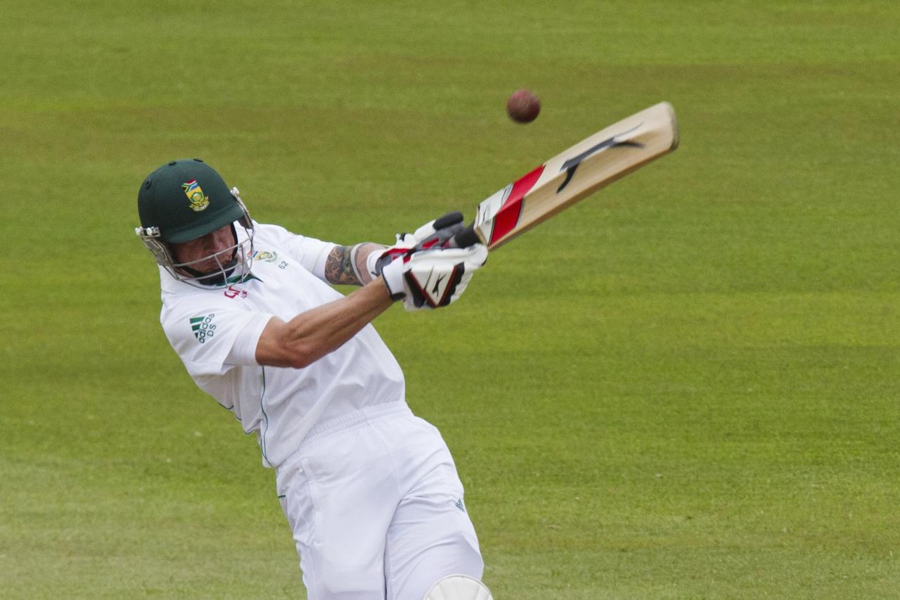 South Africa's Dale Steyn plays a shot during the fourth day of the second test cricket match against India in Durban, December 29, 2013. REUTERS/Rogan Ward (SOUTH AFRICA - Tags: SPORT CRICKET)