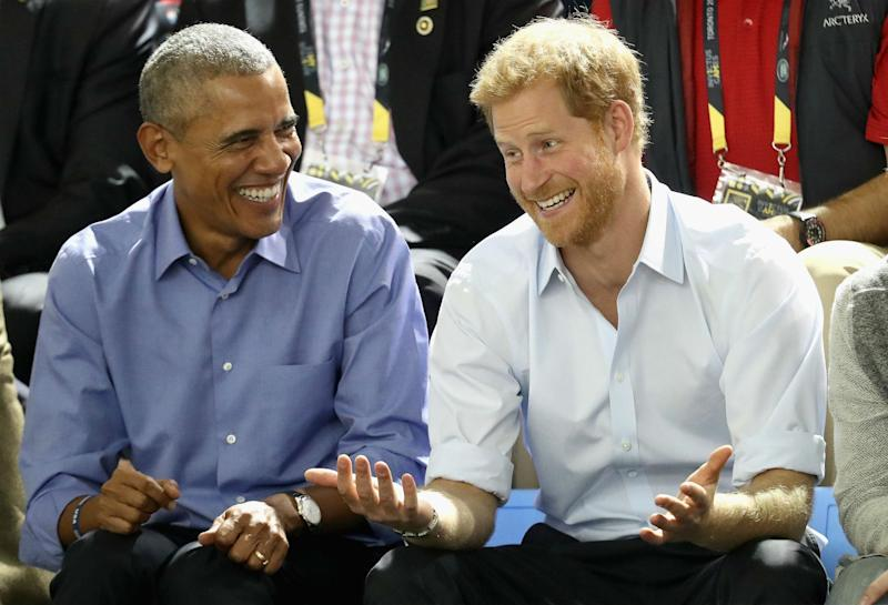 Former US President Barack Obama and Prince Harry share a joke as they watch wheelchair basketball on day 7 of the Invictus Games 2017 on September 29, 2017 in Toronto, Canada