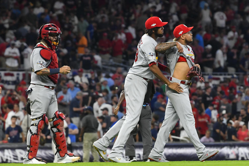 St. Louis Cardinals relief pitcher Carlos Martinez, right, celebrates with teammates after Game 1 of a best-of-five National League Division Series against the Atlanta Braves, Thursday, Oct. 3, 2019, in Atlanta. The St. Louis Cardinals won 7-6. (AP Photo/John Amis)