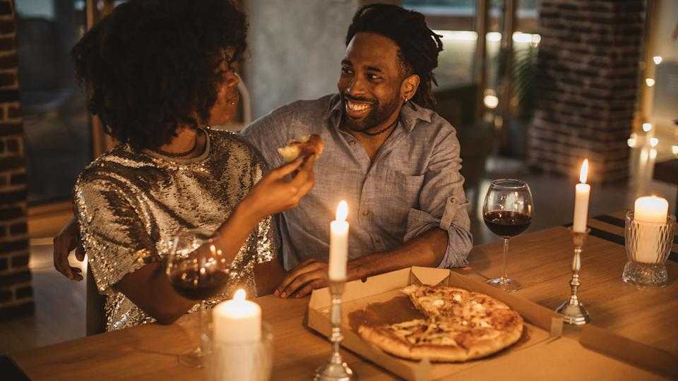 Young couple having romantic dinner at home.