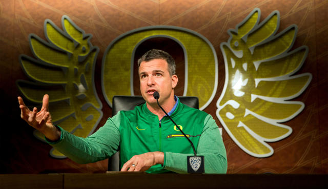 FILE - In this March 6, 2018, file photo, Oregon football head coach Mario Cristobal gestures during a news conference in Eugene, Ore. The Pac-12 has five new coaches this season, so there was extra importance on spring football this year at UCLA, the two Arizona schools and the two Oregon schools. (Andy Nelson/The Register-Guard via AP, File)