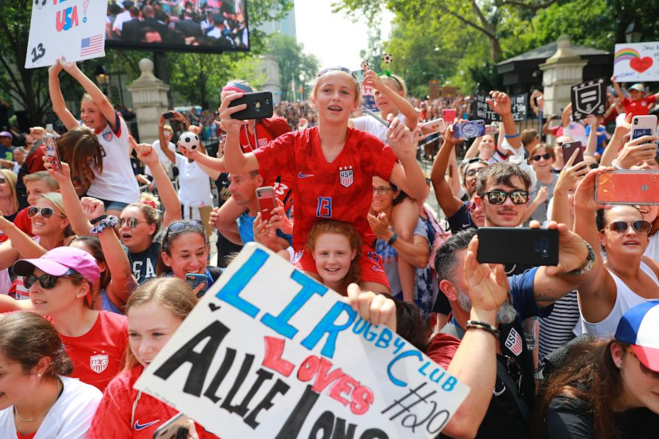Fans celebrate as members of the U.S. women's soccer team pass by during a ticker tape parade along the Canyon of Heroes, Wednesday, July 10, 2019, in New York. (Photo: Gordon Donovan/Yahoo News)