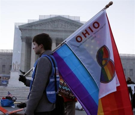 A protester from Ohio carries a flag outside of the U.S. Supreme Court in Washington