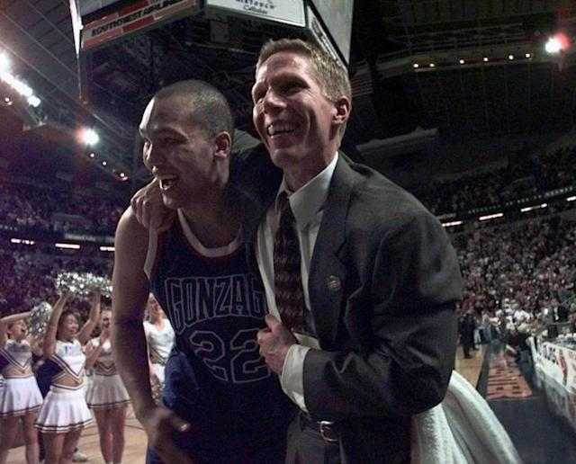 Gonzaga's Mike Leasure, left, and assistant coach Mark Few celebrate after they beat Stanford 82-74. (AP)