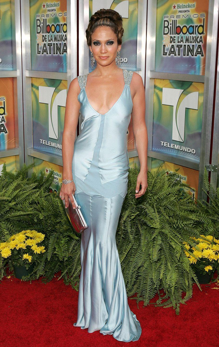 <p>Jennifer wears a gorge satin gown with sparkly straps with a metallic clutch and intricate updo at the Billboard Latin Music Awards.</p>