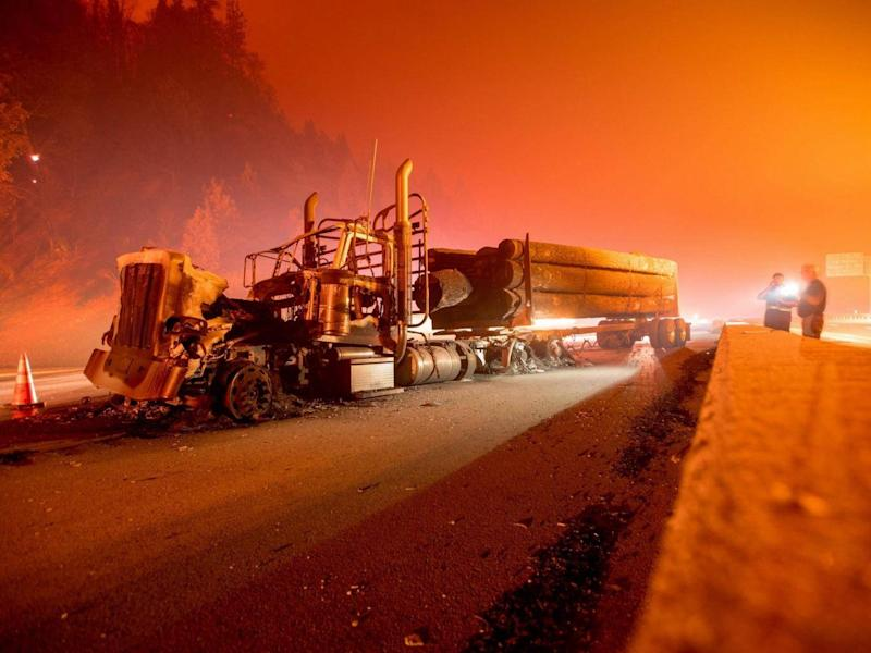 Several lorries caught fire along Interstate 5 after the wildfire tore through the region (JOSH EDELSON/AFP/Getty Images)