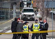 <p>Police are seen near a damaged van in Toronto after a van mounted a sidewalk crashing into a number of pedestrians on Monday, April 23, 2018. THE CANADIAN PRESS/Aaron Vincent Elkaim </p>