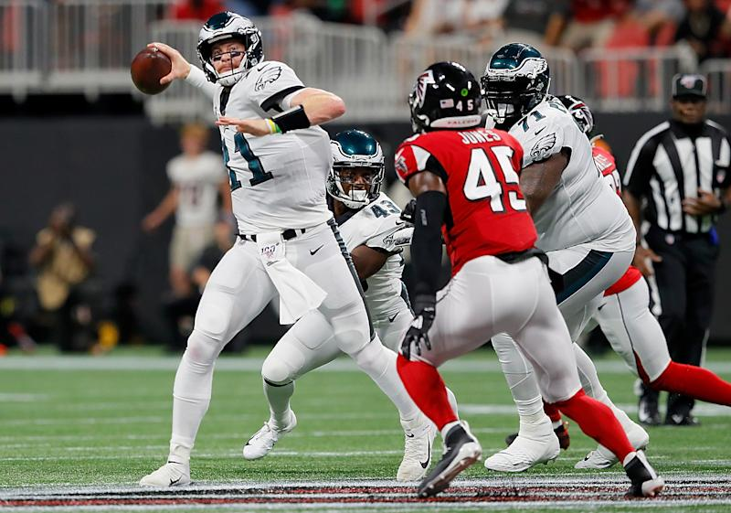 Quarterback Carson Wentz had to get checked for a concussion during Sunday night's game. (Getty Images)