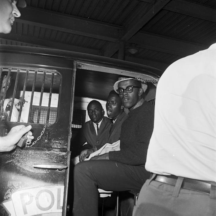 Freedom Riders in the back of a police van after their arrest at the Greyhound station in Birmingham, Alabama in May 1961.