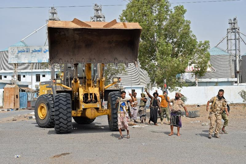 Yemeni pro-government fighters use bulldozers to smash though rebel defences as they advance towards Hodeida's vital docks (AFP Photo/Khaled Ziad)