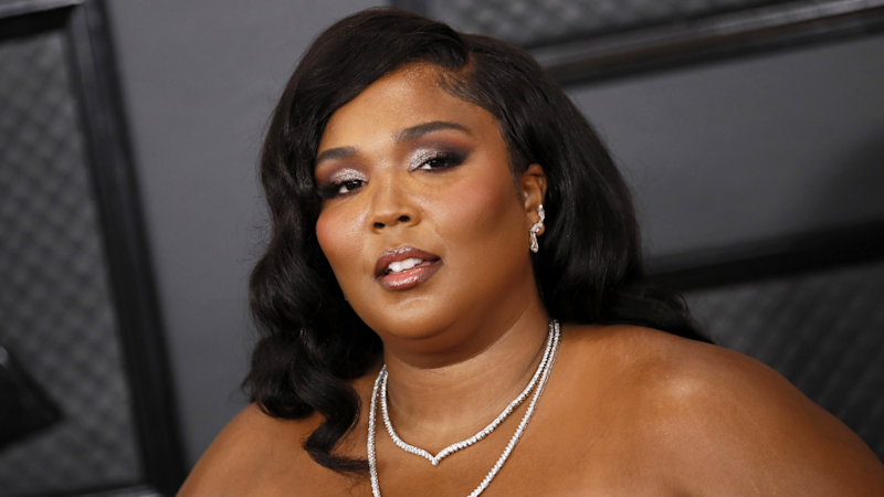 These Photos of Lizzo Wearing the Most Dramatic Dress of All Time Are Guaranteed to Brighten Your Day