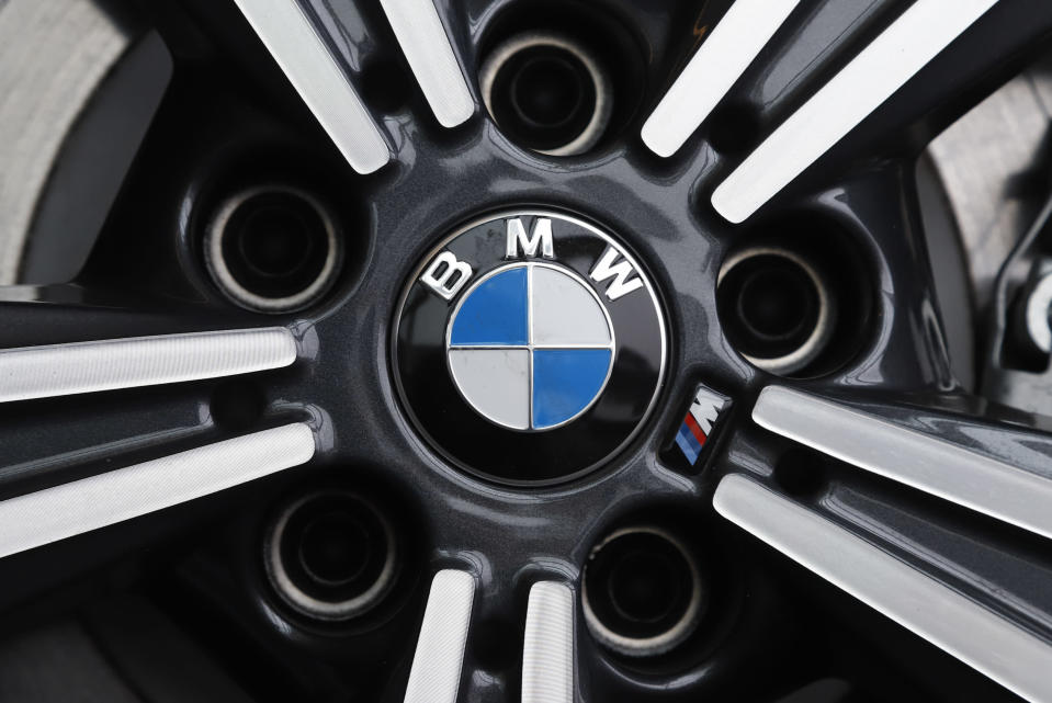 FILE - In this Feb.13, 2020 file photo, a wheel on a BMW car is on display at the 2020 Pittsburgh International Auto Show. German automaker BMW said third-quarter net profit rose 17% to 1.81 billion euros ($2.22 billion) as regional auto markets recovered and highly profitable luxury models such as the 8 Series coupe and X7 large sport-utility vehicle helped fatten the bottom line. (AP Photo/Gene J. Puskar, File)