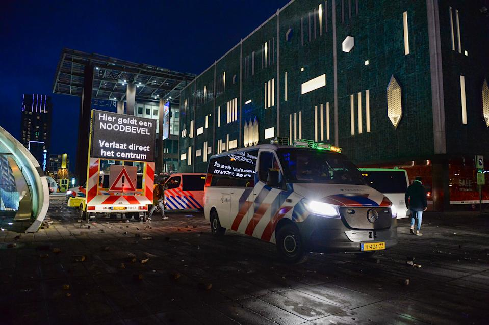 EINDHOVEN, NETHERLANDS - JANUARY 24: Police are seen in the city centre near Eindhoven Central Station on January 24, 2021 in Eindhoven, Netherlands after a forbidden protest against the coronavirus measures turned into riots. Police cleared the area in and around Central Staition after rioters looted a supermarket and set fore to a car. (Photo by Joris Verwijst/BSR Agency/Getty Images)