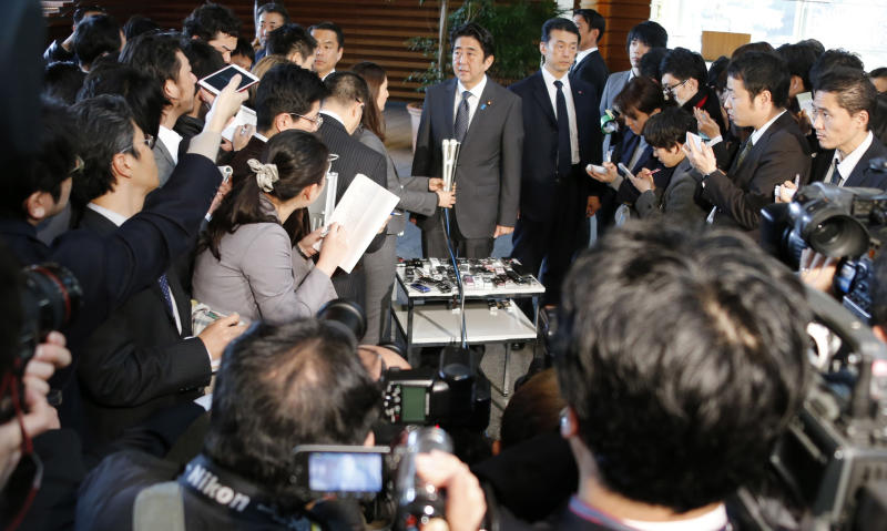 "Japanese Prime Minister Shinzo Abe speaks to the reporters after meeting with Finance Minister Taro Aso, Economics Minister Akira Amari and Bank of Japan Gov. Masaaki Shirakawa, at the prime minister's official residence in Tokyo, Tuesday, Jan. 22, 2013. Japan's Prime Minister Abe declared a ""monetary regime change"" Tuesday as the central bank bowed to government pressure, setting a 2 percent inflation target aimed at helping the country emerge from its prolonged bout of deflation. (AP Photo/Koji Sasahara)"