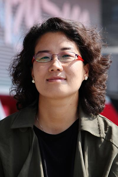 "In this Oct. 4, 2013 photo, South Korean Director Kim Lyang poses during an interview with the Associated Press at Busan Cinema Center in Busan, South Korea. The 41-year-old Kim struggled to reconcile her father's origin growing up during a time of widespread fear of another communist invasion and North Korean spies. ""It did not feel natural for me to say my father's hometown was North Korea,"" Kim said during the interview. (AP Photo/Woohae Cho)"