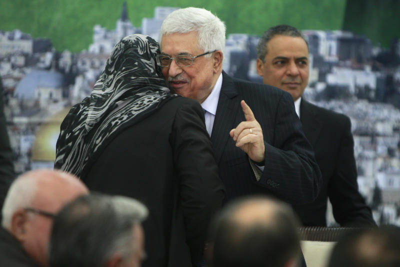 Palestinian President Mahmoud Abbas, center, attends a meeting of the Palestinian leadership at his compound in the West Bank city of Ramallah, Tuesday, Dec 4, 2012. Israel's latest settlement plans will destroy any lingering hopes of setting up a Palestinian state next to Israel, a senior Palestinian official warned Tuesday, as international anger over such construction snowballed. (AP Photo/Majdi Mohammed)