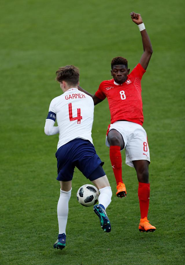 Soccer Football - UEFA European Under-17 Championship - Group A - Switzerland v England - AESSEAL New York Stadium, Rotherham, Britain - May 10, 2018 England's James Garner in action with Switzerland's Alexandre Jankewitz Action Images via Reuters/Lee Smith