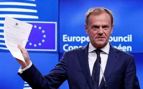 European Council President Donald Tusk shows British Prime Minister Theresa May's Brexit - Credit:  YVES HERMAN