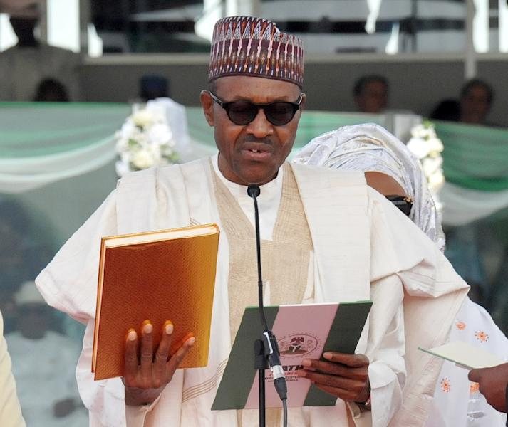 New President Muhammadu Buhari said after taking the oath of office on Friday he would review military rules of engagement to try to end concerns of rights violations by soldiers (AFP Photo/STRINGER)