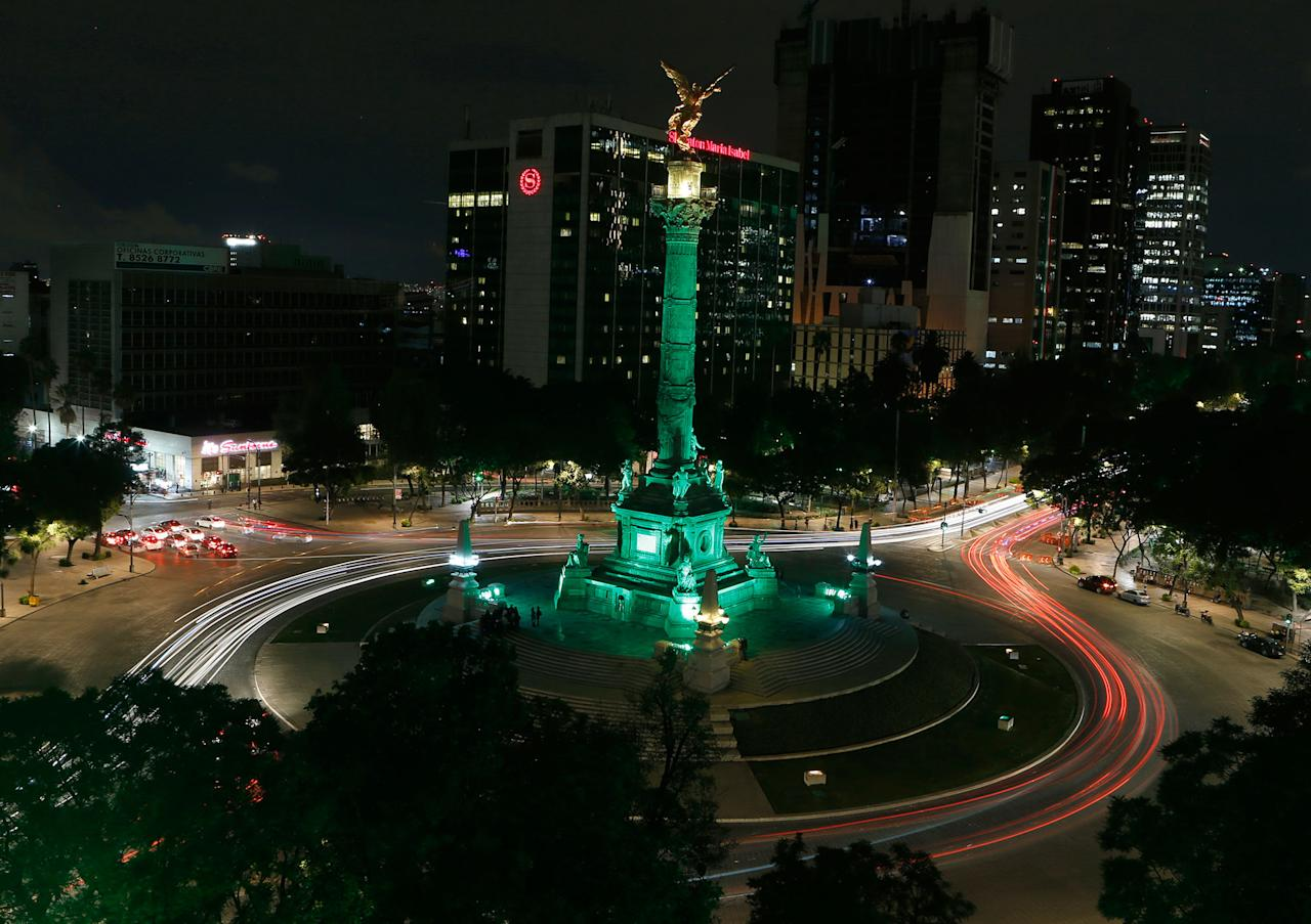 <p>Cars drive past the Angel of Independence monument, lit up in green in Mexico City, Thursday, June 1, 2017. Mexico City's Mayor Miguel Angel Mancera announced on his Twitter account that the city would light up in green to reaffirm Mexico's support for the Paris climate agreement after President Donald Trump withdrew the U.S. from the accord. (AP Photo/Marco Ugarte) </p>
